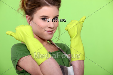 Young Women Wearing Rubber Gloves And Apron Stock Photo