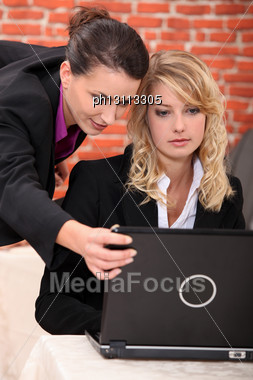 Young Women Working At A Laptop Stock Photo