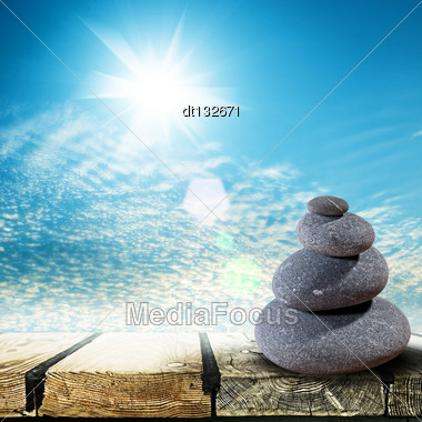Zen Stones Over Wooden Desk, Abstract Environmental Backgrounds Stock Photo