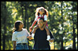 Families African American Family Walking in Park - stock image