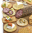 Stock Photo : Crackers Pictures: Assorted Crackers With Salami ,Cheese And Dips