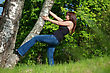 Stock Photo : Playful Stock Image: Beauty Tomboy Trying To Get Up The Tree
