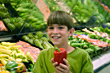Boy Holding Pepper in Grocery Store stock photography