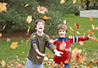 Stock Photo : Face Pictures: Boys Playing in the Leaves