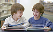 Brothers Reading Together stock photo