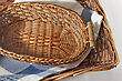 Brown Wicker Basket With A Blue Gingham Cloth For Table Appointments - stock photography