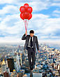 Professional Businessman Flying High With Helium Balloons. - stock photography