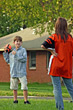 Playful Children Playing Backyard Football stock photo
