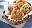 Cinnamon Danish Bun In The Basket On Textile Background - stock photography