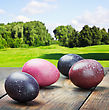 Colored Easter Eggs On A Wooden Table In A Landscape - stock image