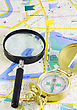 Compass And Magnifying Glass On The Map stock image