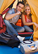 Couple Camping In Tent With Radio