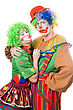 Artistic Couple Of Funny Clowns. stock photo