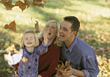 Families Family Playing with Fall Leafs - stock photo