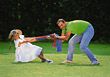 Stock Photo : Smiling Pictures: Father and Dauther Playing Outdoors