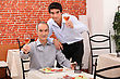 Seniors Father And Son Having Dinner Together stock photography
