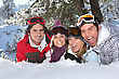 Four Friends Laying In The Snow stock photography
