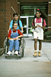 Children Friends with Girl in Wheelchair stock photography