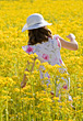Stock Photo : Field Pictures: Girl Dressed up in a Flower Field