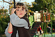 Stock Photo : Serious Stock Image: Girl Holding Onto A Rope In A Playground