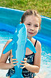 Stock Photo : Smiling Pictures: girl in the swimming pool