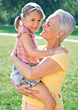 Stock Photo : Seniors Stock Image: Grandmother Holding Granddaughter In Arms