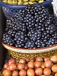 Grapes And Mangosteens, Bali, Asia; Baskets Of Fruits In A Market stock photo