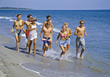 Group of teenagers jogging on the beach