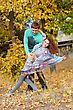 Happy Young Couple Dancing In The Park stock photography