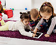 Kids with tablet in the room stock photography