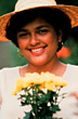 Latino Woman with Hat and Flowers