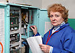 Industry Operator Woman-engineer In Machine Room (elevator) Near Electronic Cabinet stock photo