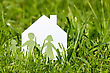 Small Paper Cut Of Family With House In A Green Grass stock photography