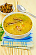 Stock Photo : Crackers Stock Photo: Pea Soup In A Bowl On A Napkin, Spoon, Crackers Against A Wooden Board