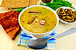 Stock Photo : Crackers Stock Photography: Pea Soup In A Bowl, Rye Crackers On A Plate, Spoon, Pepper, Crispbread, Cloth, Bacon, Dill Against A Wooden Board