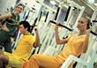 Stock Photo : Trainer Pictures: People In Gym with Personal Trainer