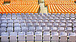 Plastic Yellow And Pink Chairs In Summer Amphitheatre. stock photo