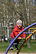 Stock Photo : Playful Stock Photography: Portrait Of A Child - A Little Girl Playing In The Park