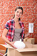 Stock Photo : Packing Stock Image: Portrait Of A Woman With Moving Boxes