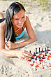 Face Portrait Of Pretty Woman Playing Chess On The Beach stock photo