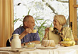 Retired Couple Having Coffee and Cake stock image