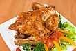 Stock Photo : Meat Pictures: Roasted Chicken Garnished With Fresh Tomatoes, Green Salad, Pepper And Greens
