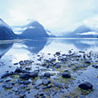Snowcapped Mountains & Fjord, New Zealand - stock photo