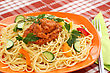 Spaghetti Pasta With Sauce And Vegetables On Table stock photo