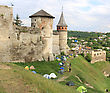 Tents Under Ancient Castle Walls stock photography