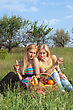 Stock Photo : Basket Pictures: Two Attractive Blonde With Wineglasses Sitting On A Grass