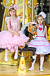 Two Little Elegant Girls Posing On The Carousel stock photography