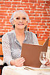 Woman Reading A Menu In A Restaurant stock photography