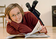 Stock Photo : Face Pictures: Woman Wearing Glasses Reading On Floor