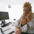 Stress Working Mom with Baby on Lap stock photo